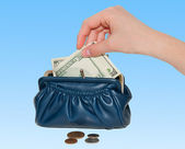 Hand takes out money from the purse — Stock Photo