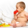 Baby boy playing in the bed — Stock Photo