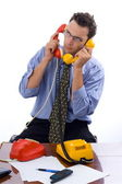 Talking on two telephones — Stock Photo