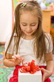 Unpackign the gift — Stock Photo