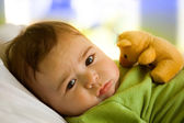 Baby boy with toy bear — Stock Photo
