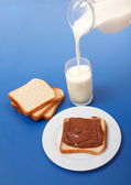 Milk and bread with chocolate — Stock Photo