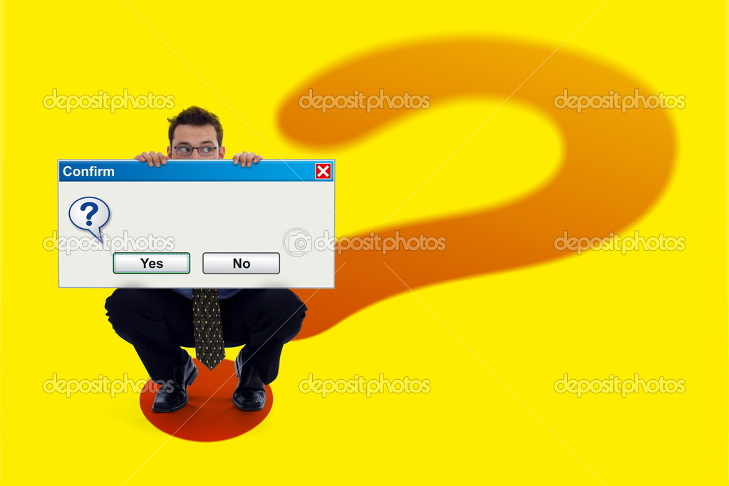 Businessman holding a big (empty) software confirmation dialog. He is standing on a big question mark background  Stock Photo #4017863
