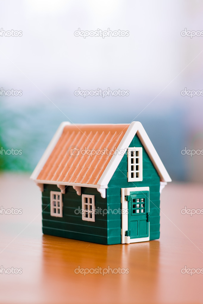 Miniature toy house on the table — Stock Photo #4018036