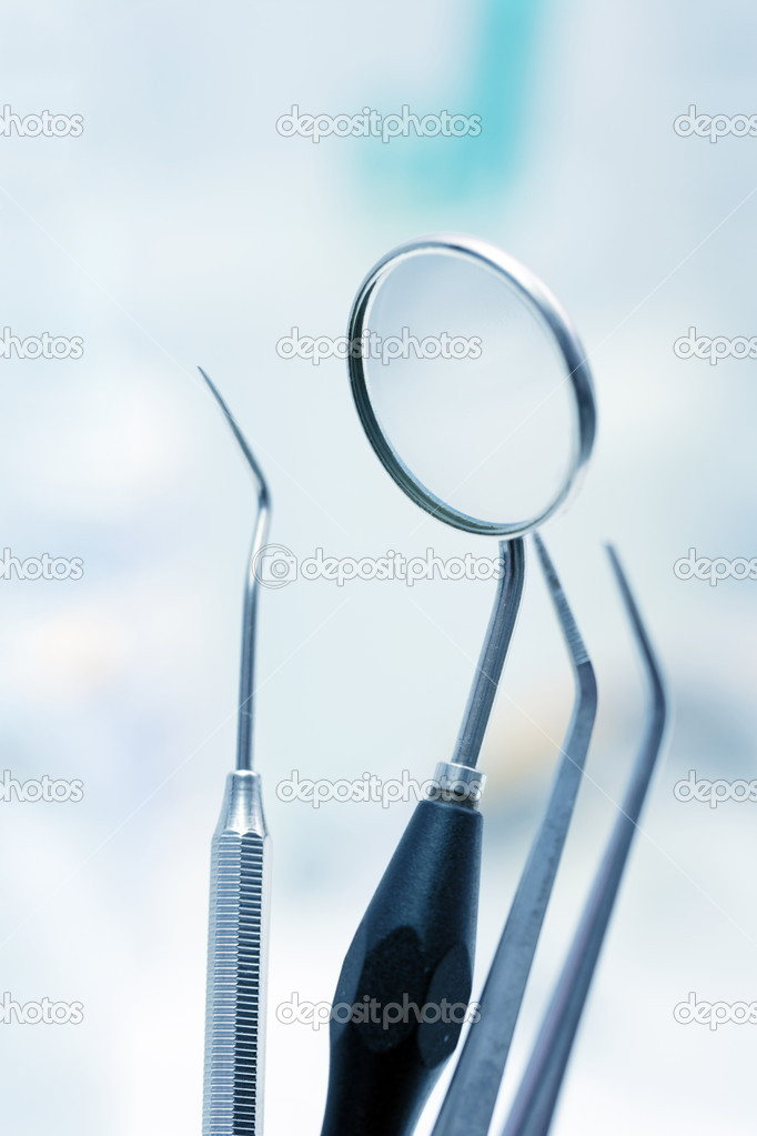 Dentist tools in blue light (shallow DOF)  Stock Photo #4018232