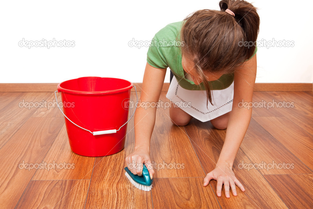 Woman cleaning the floor by hand with brush — Stock Photo #4018911