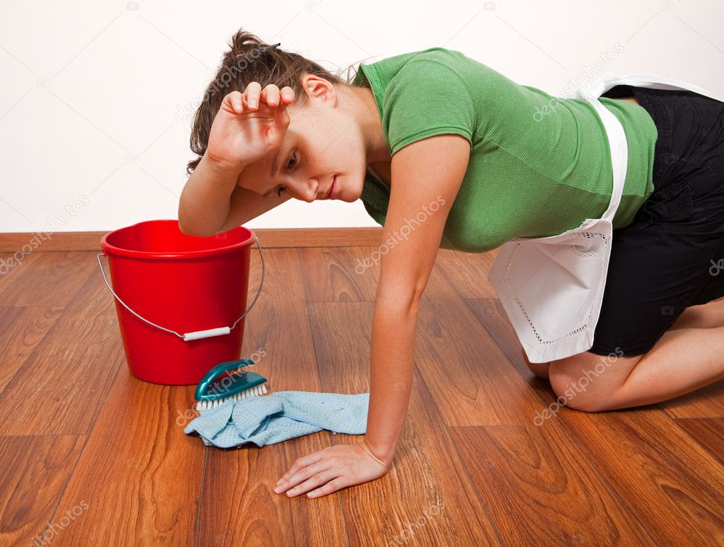Woman getting tired after hard work of floor cleaning — Stock Photo #4018914
