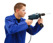 Young man with drill — Stock Photo