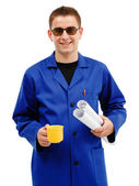 Young technician taking coffee break — Stock Photo
