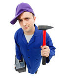 Awkward repairman with hammer — Stock Photo