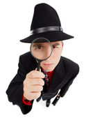 Young detective with magnifier — Stock Photo