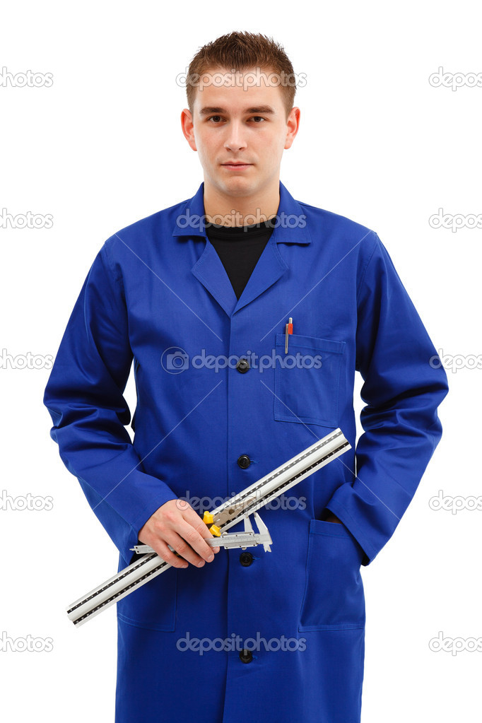 Young engineer with his tools, ruler, caliper and pliers  Stock Photo #4140863