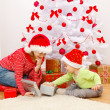 Royalty-Free Stock Photo: Children opening presents in Christmas