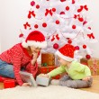 Children opening presents in Christmas — Stock Photo