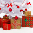 Presents under white christmas tree — Stock Photo