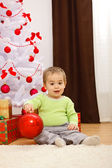 Happy little boy with big Christmas ornament — Stock Photo