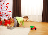 Little boy in Christmas, playing with new toy car — Stock Photo
