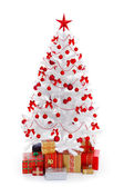 White Christmas tree with presents and red decoration — Stok fotoğraf