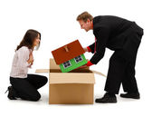 Business man unpacking a new house for wife or client — Stock Photo