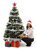 Young woman near christmas tree with presents — Stok fotoğraf