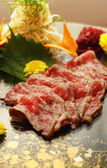 Rare wagyu beef served on black platter — Stock Photo