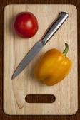 Tomato, knife, pepper — Stock Photo