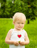 Young blond girl in the city park — Stock Photo