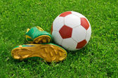 Ball and cleats — Stock Photo