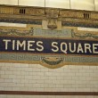 Tiimes square sign on entrance to subway — Stock Photo