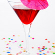 Red cocktail with paper drink umbrella — Stock Photo