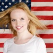 Young Girl and american flag — Stockfoto