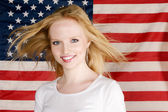 Young Girl and american flag — Stok fotoğraf