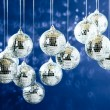 Mirrored disco balls with light spots over background - Stock Photo