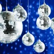 Mirrored disco balls with light spots over background — Stock Photo #3967165