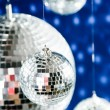 Mirrored disco balls with light spots over background — Stock Photo #3967174