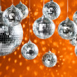 Mirrored disco balls with light spots over background — Stock Photo #3967182