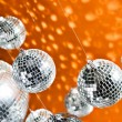 Mirrored disco balls with light spots over background — Stock Photo