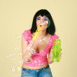 Beautiful young woman playing with soap bubbles - Stockfoto