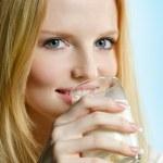 Lovely teenager girl drinking milk — Stock Photo #3967459