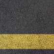 Asphalt surface with yellow line - Stock Photo