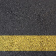 Asphalt surface with yellow line — Stock fotografie