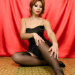 Sexy young woman sitting on floor — Stock Photo #3967887