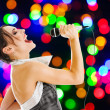 Stock Photo: Singer at night club