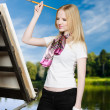 Painter artist behind easel - Stock Photo