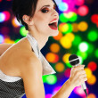 Stock Photo: Singer at a night club