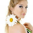 Stock Photo: Young woman with daisy flower