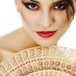 Stock Photo: Beautiful young woman with fan isolated