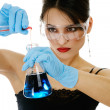 Beautiful woman with chemical glassware — Stock Photo