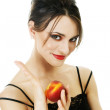 Young woman with peach — Stock Photo