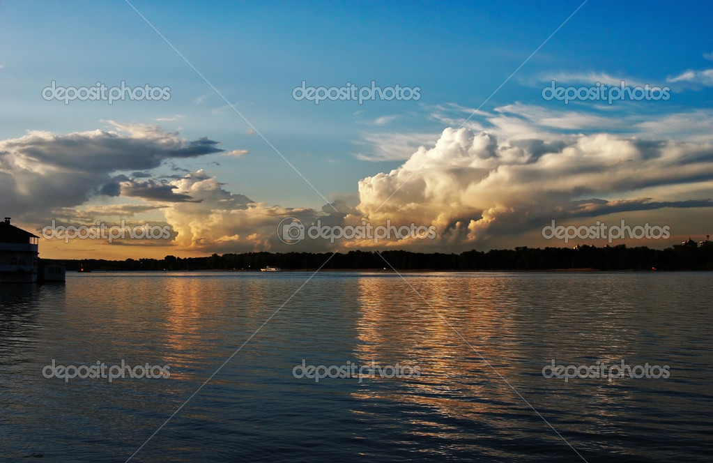 Sunset over river with reflections in water — Stock Photo #3972975
